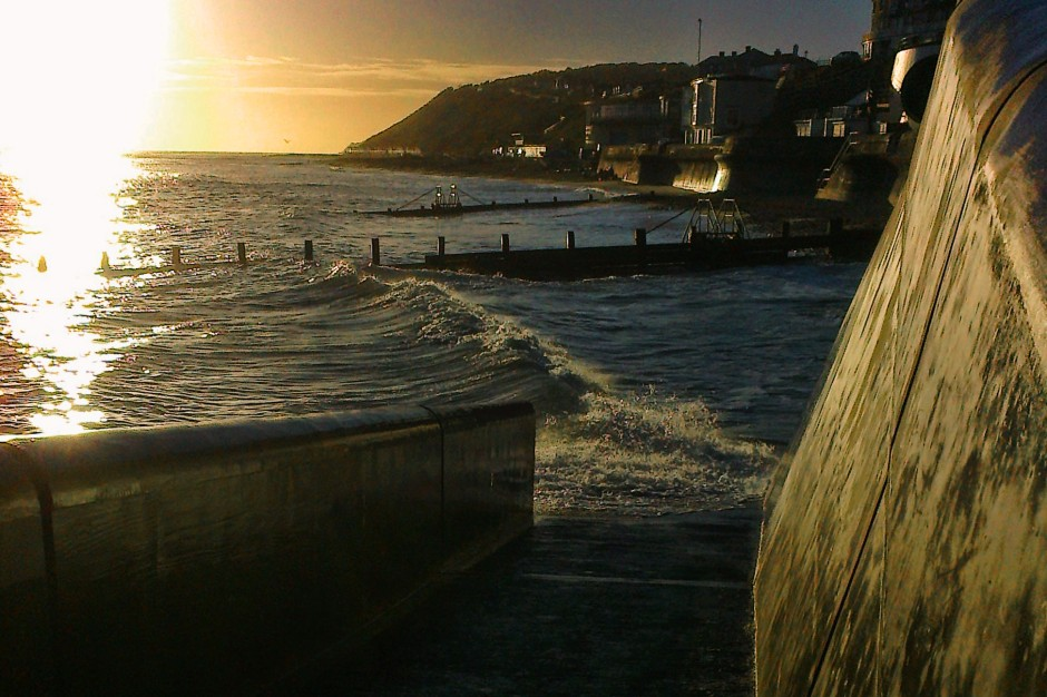 Cromer seafront at high tide at sunrise