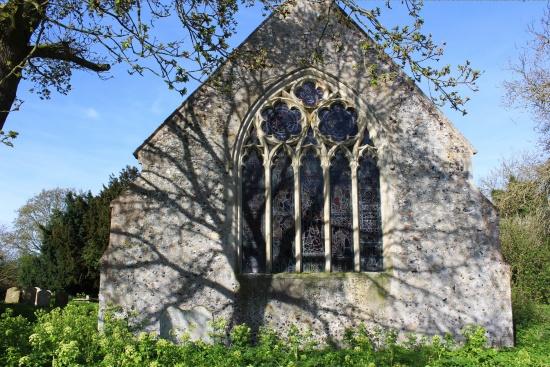 Hellington church east window