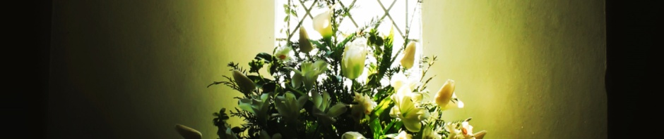 Flowers in church window cropped