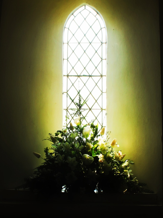 Flowers in church window
