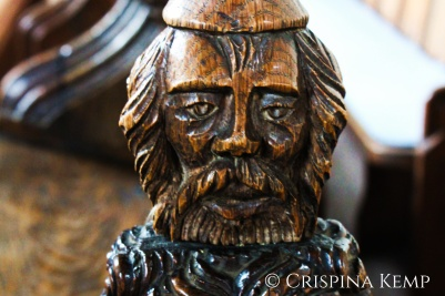 wooden pew end man
